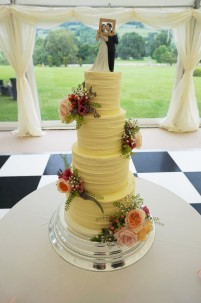 4 tier rustic buttercream cake with fresh flowers