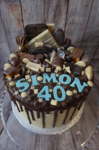 Loaded chocolate cake with name and age