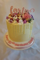 White chocolate drop cake with edible flowers, iced board and personalised message- £65 (topper not included)