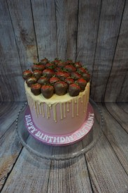 White chocolate drip cake with chocolate coated strawberries- £55
