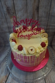 Raspberry and white chocolate drip cake- £45 (topper not included)