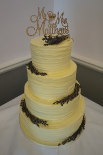 3 tier rustic buttercream cake decorated with lavender