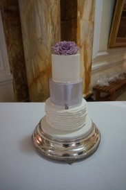 3 tier fondant cake with handmade roses, starting at £350