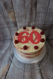 White chocolate and raspberry cake with large age numbers- £50
