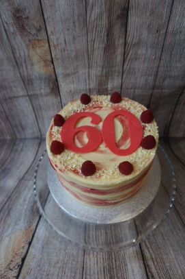White chocolate and raspberry cake with large age numbers