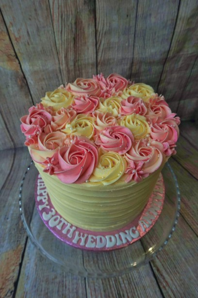 Piped buttercream rose cake with personalised message