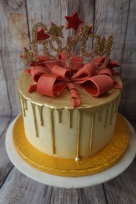 Gold drip cake with handmade bow- £65 (topper not included)