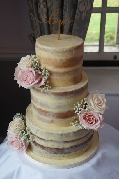 3 tier semi-naked cake with fresh flowers