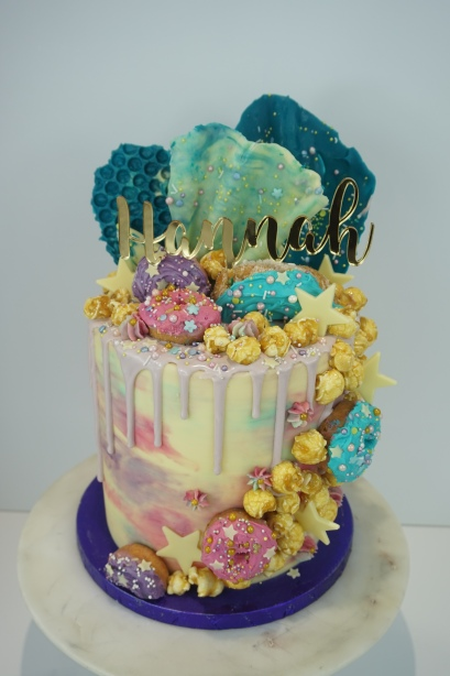 Mermaid cake with hand iced donuts and handmade chocolate sails