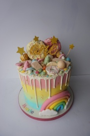 Loaded rainbow drip cake with handmade rainbow £65