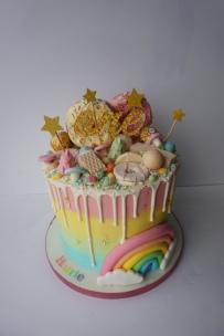 Loaded rainbow drip cake with handmade rainbow