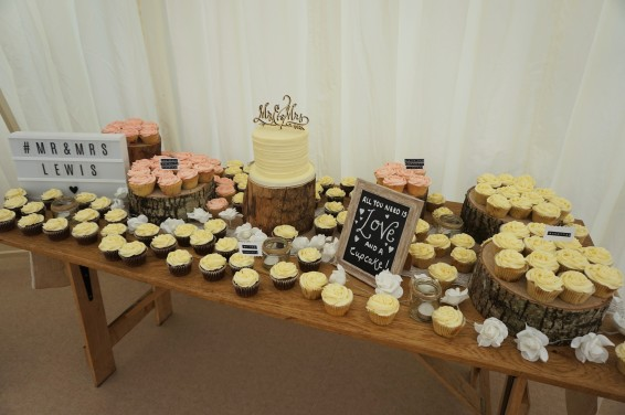 Dessert table with cutting cake and cupcakes
