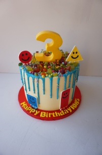 Mister Maker themed drip cake with chocolate number and edible images