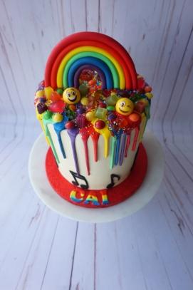 Rainbow cake with rainbow drip and handmade rainbow